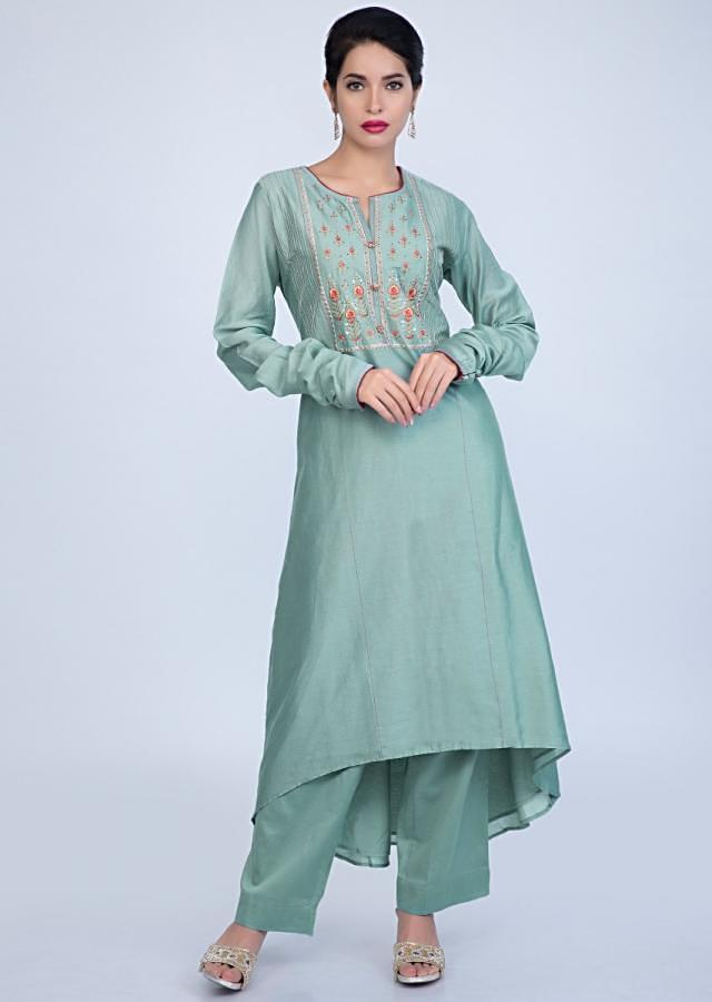 Turq Blue Suit With Embroidery Work Teamed With Matching Pant And Contrasting Red Dupatta Online - Kalki Fashion