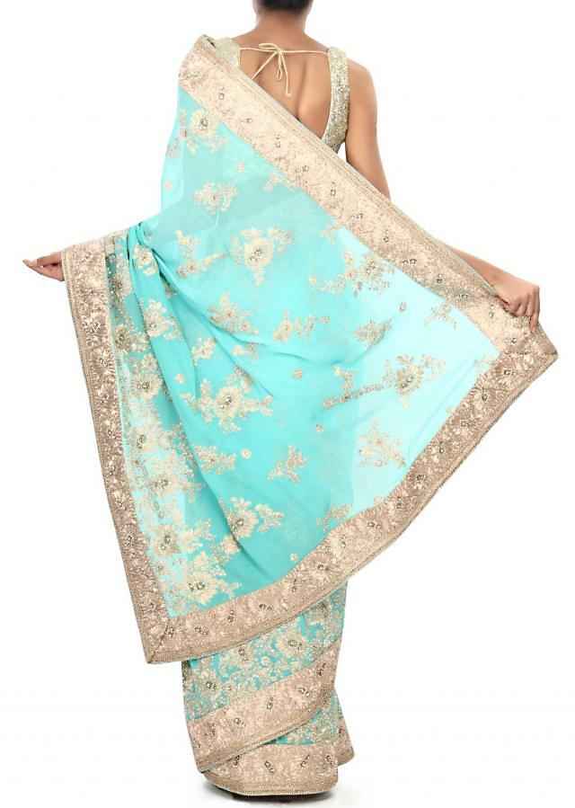 Turq blue saree enhanced in pearl and zari embroidery only on Kalki