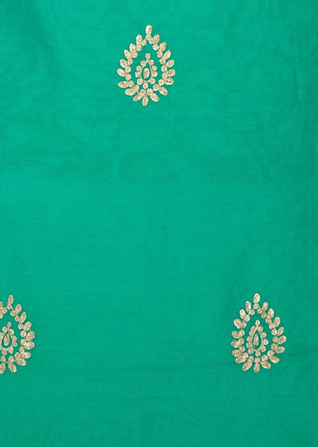Turq blue unstitched suit in silk with zari embroidered butti only on Kalki