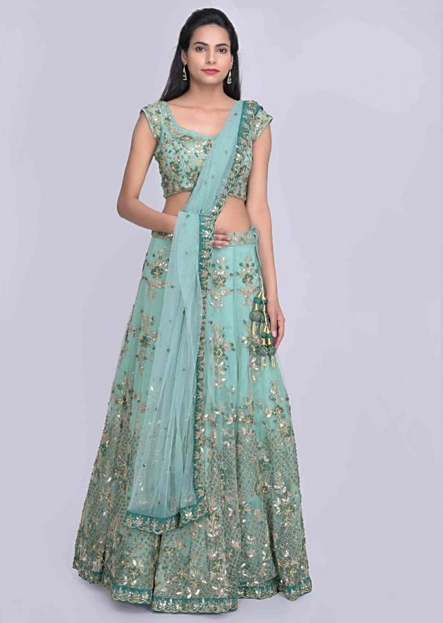 Turq green embroidered net lehenga set with satin under layer only on Kalki