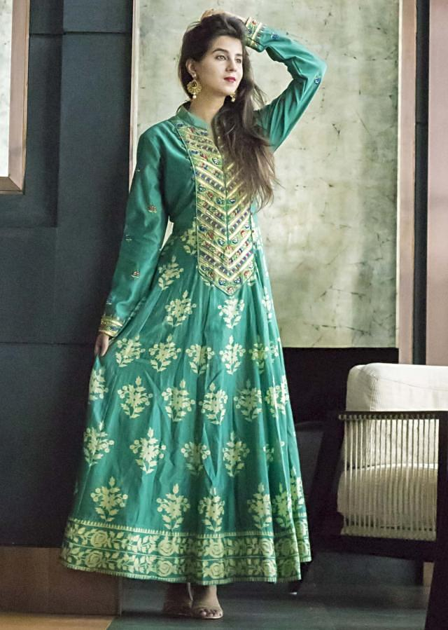 Turq green printed dress with resham embrodiered placket only on Kalki