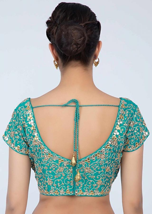 Turq green raw silk blouse with jaal embroidery only on Kalki