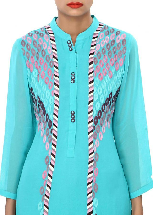 Turq kurti embellished in resham embroidery only on Kalki