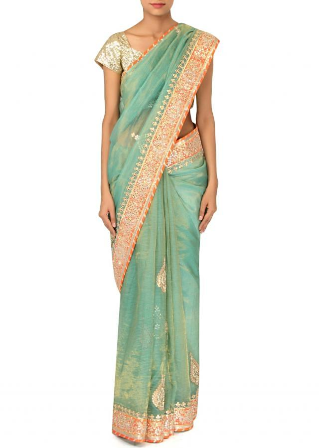 Turq saree adorn in gotta patch embroidery only on Kalki