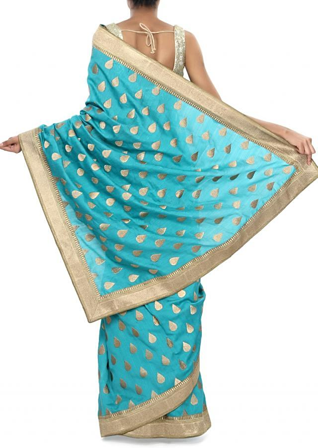 Turq saree embellished in zari weave embroidery only on Kalki