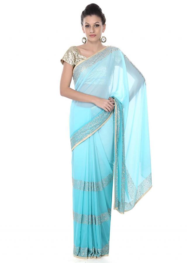 Turq shaded saree with kundan embellished border only on Kalki