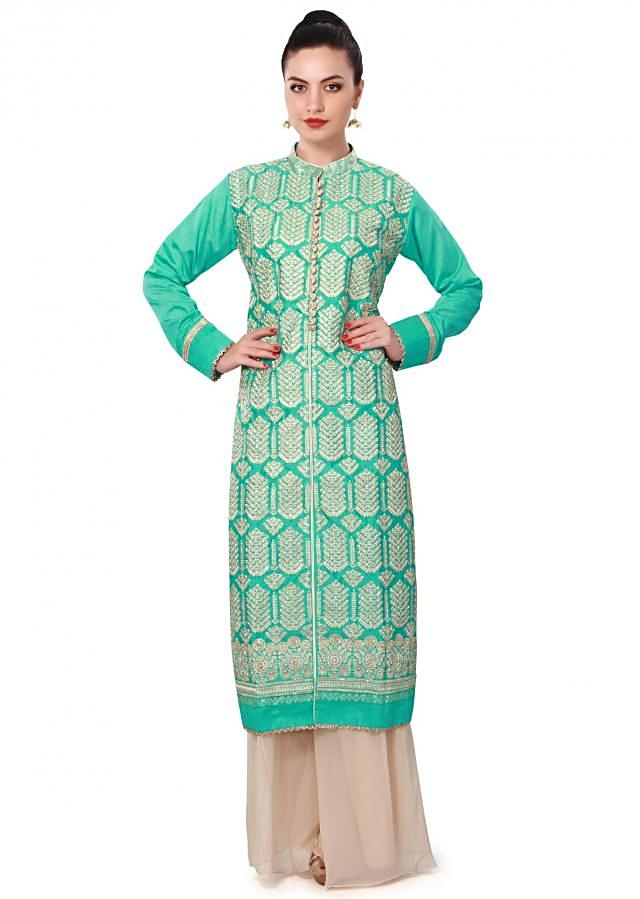 Turq straight suit adorn in resham embroidery only on Kalki
