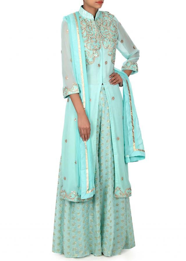 Turq straight suit embellished in gotta patch embroidery only on Kalki