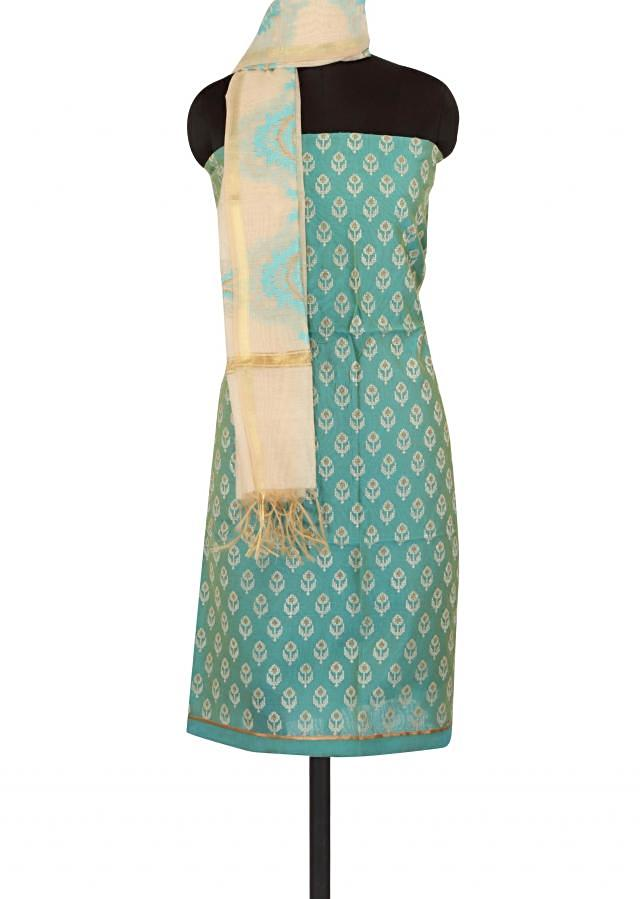 Turq unstitched suit adorn in thread embroidered butti only on Kalki