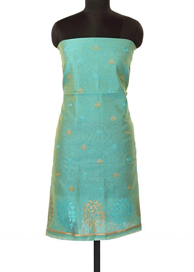 Turq unstitched suit in resham and zari butti only on Kalki