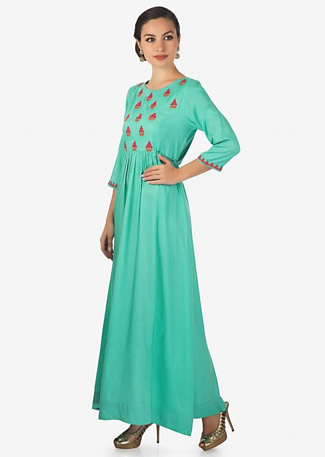 Turq blue dress adorn in embroidered butti and gathers only on Kalki