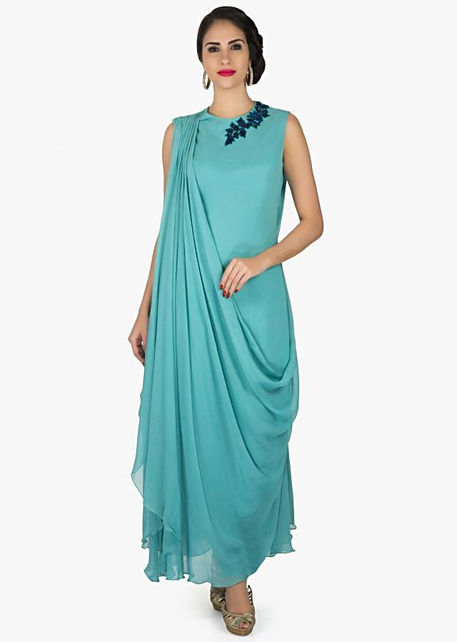 Turq blue suit in georgette with fancy drape and embroidered zari butti only on Kalki