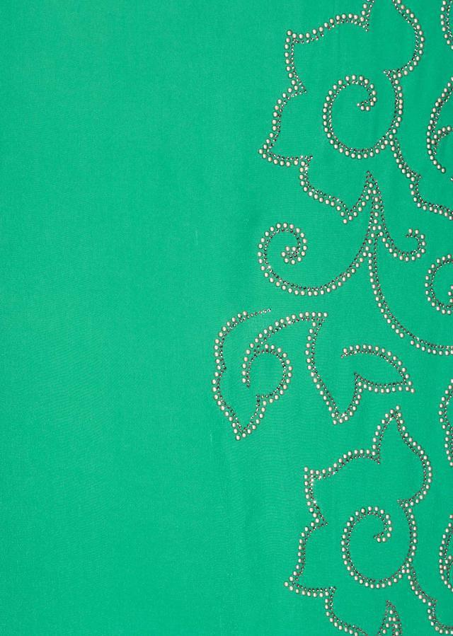 Turq green unstitched suit in crepe with kundan all over only on Kalki