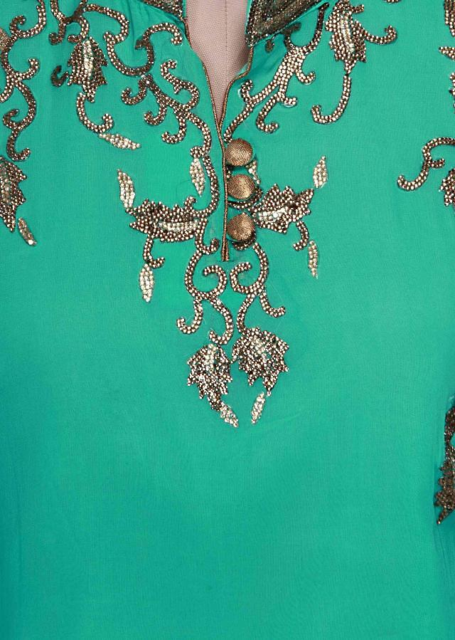 Turq semi stitched suit adorn in kundan embroidery only on Kalki