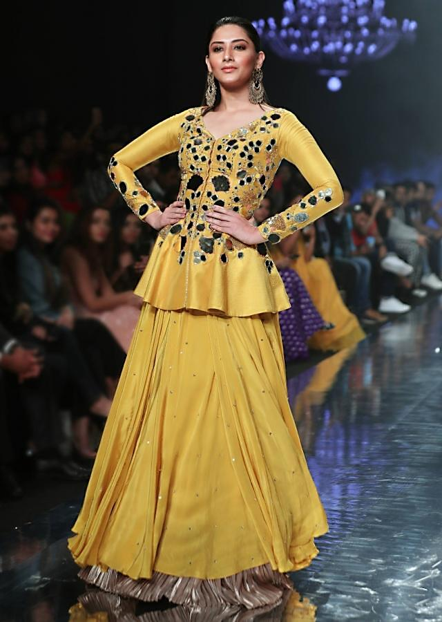 Sunset Yellow Peplum Top With Flower And Leaf Cut Mirror Work And Matching Lehenga Online - Kalki Fashion