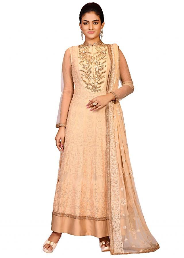 Tussar aari suit in net featuring the thread and antique embroidery work only at Kalki