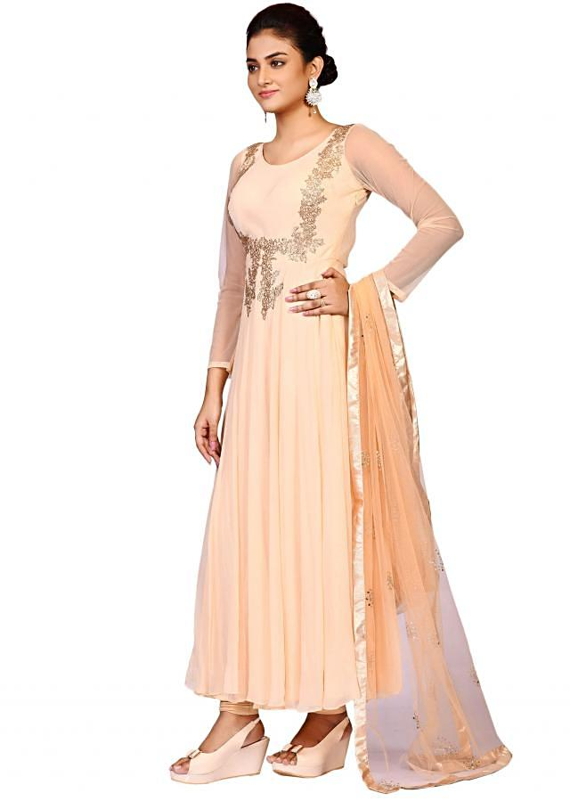 Tussar net suit with net dupatta embellished in antique embroidery only on Kalki