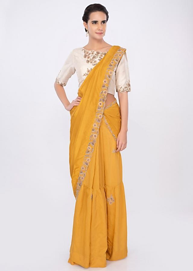 Two pieced mustard saree with cream high neck blouse only on kalki