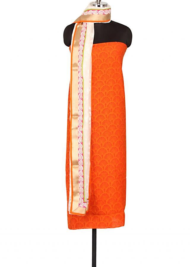 Unstitched suit featuring in printed orange  only on Kalki