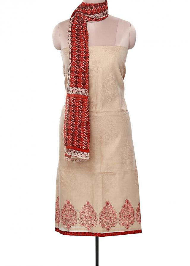 Unstitched suit in beige adorn in thread embroidery only on Kalki