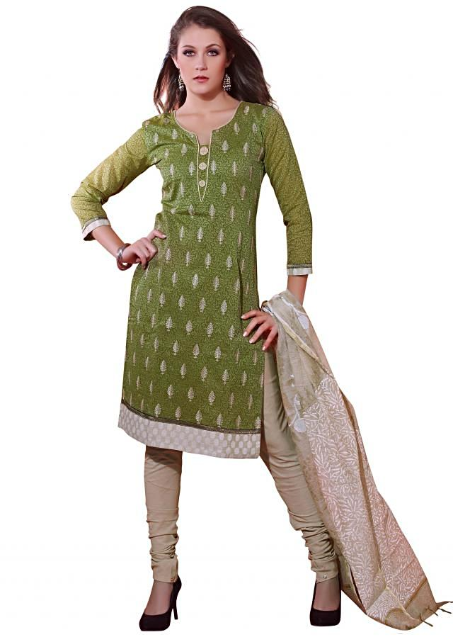 Unstitched suit in green embellished in thread butti only on Kalki