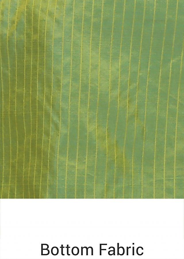Unstitched suit in green shades with red dupatta only on Kalki