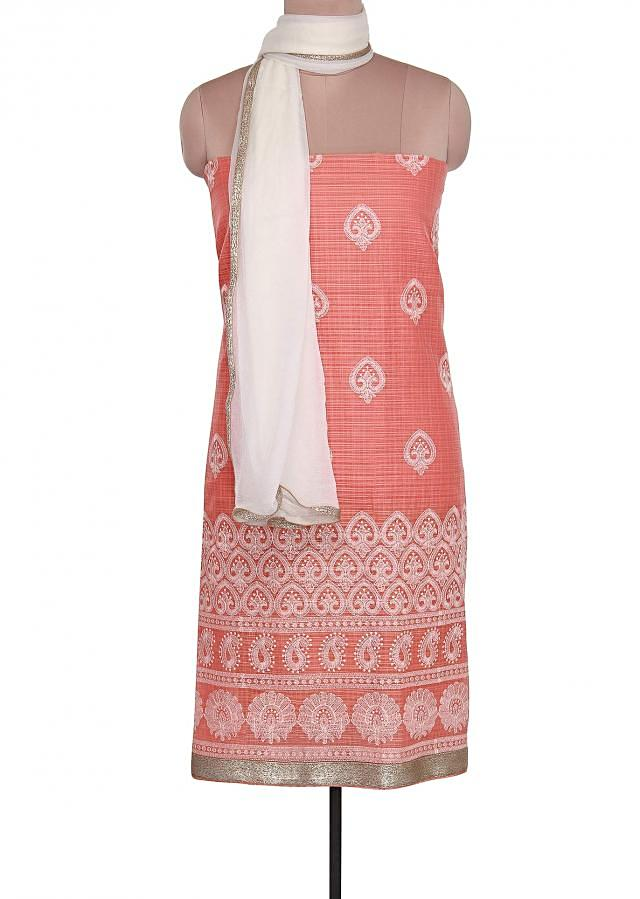 Unstitched suit in peach is embellished in thread embroidery only on Kalki