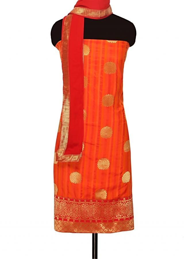 Unstitched suit in shades of orange with red dupatta only on Kalki