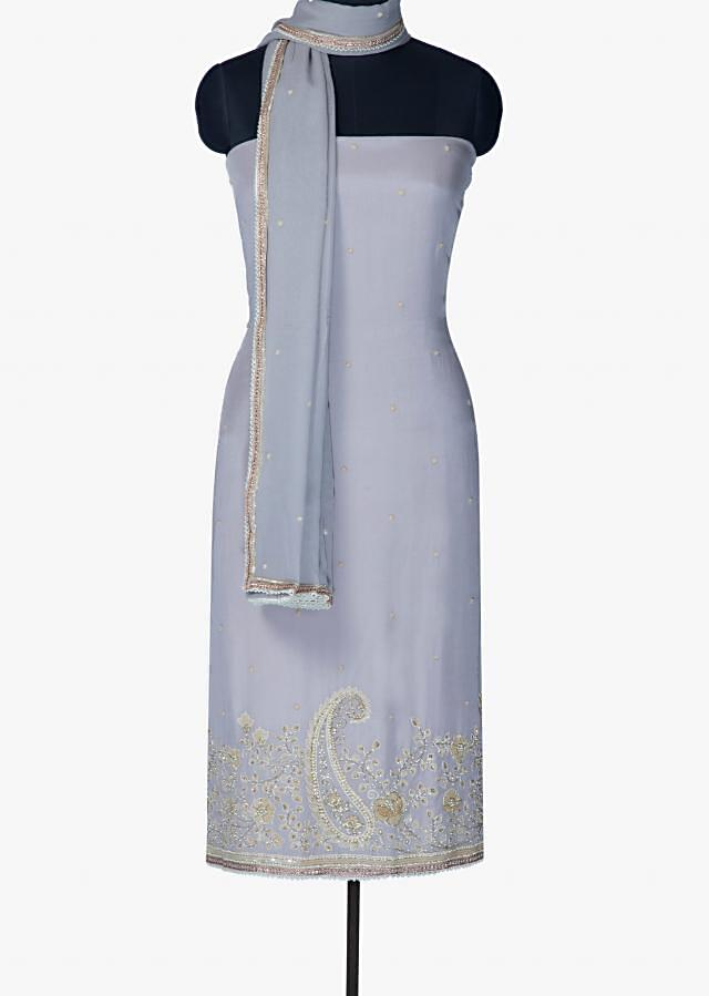 Unstitched suit in grey with hem line in sequin and moti only on Kalki