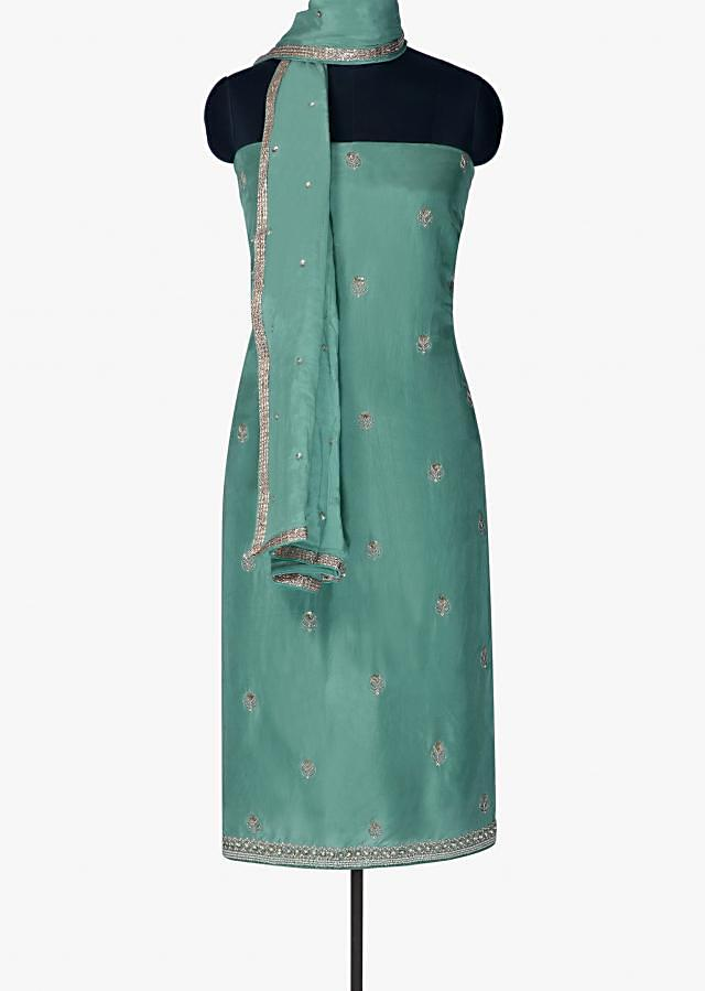 Unstitched suit in mud green silk suit with zardosi embroidery only on Kalki