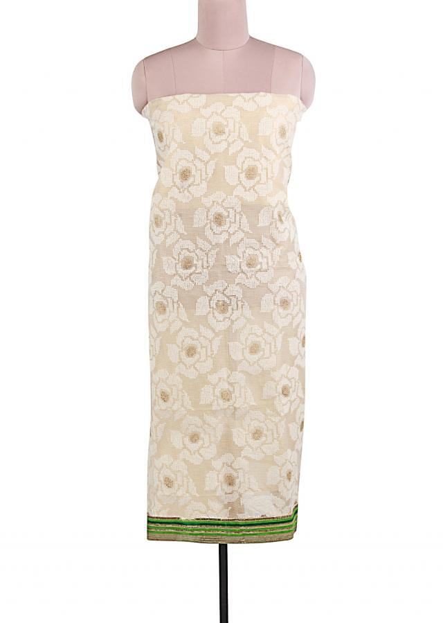 Unstitched suit in beige adorn in rose motif thread embroidery only on Kalki