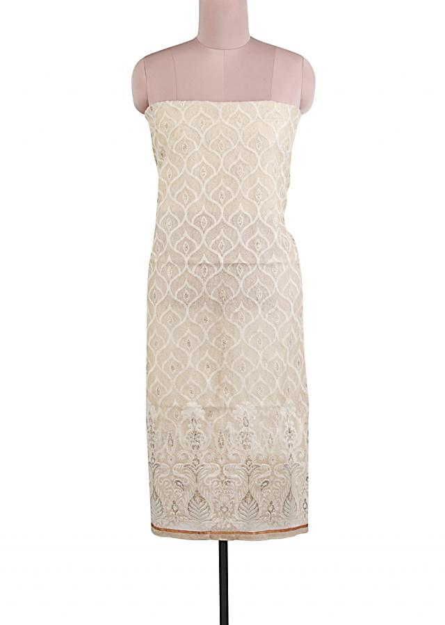 Unstitched suit in cream adorn in thread and embroidery all over only on Kalki
