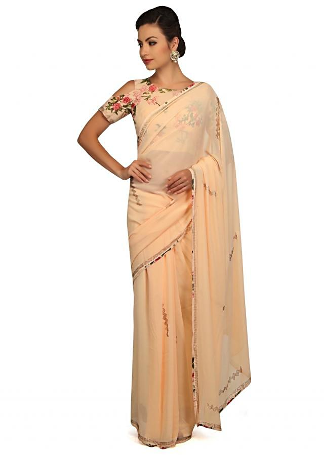 Vanilla cream saree with floral printed border and kundan only on Kalki