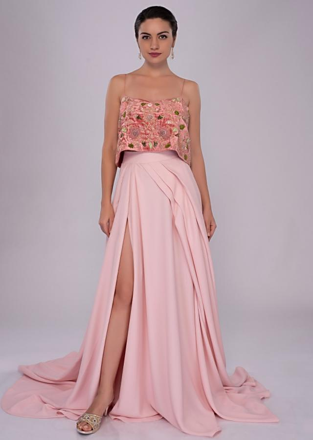 Velvet strap crop top paired with pastel pink flared skirt with slit only on Kalki