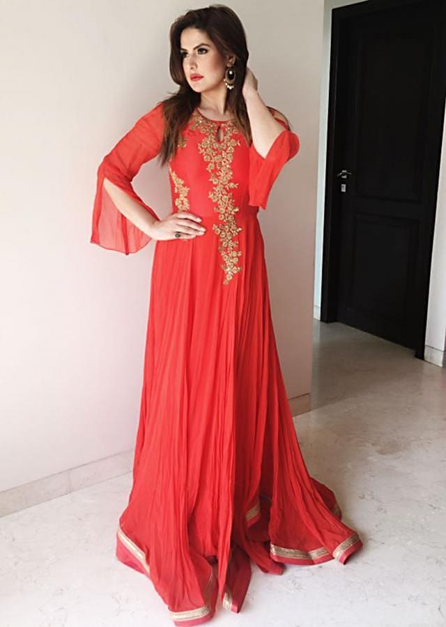 Orange georgette gown embellished in zardosi and sequin work only on Kalki