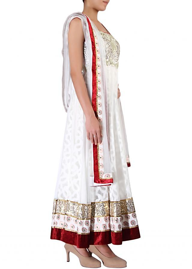 White anarkali suit adorn in embossed zari embroidery only on Kalki