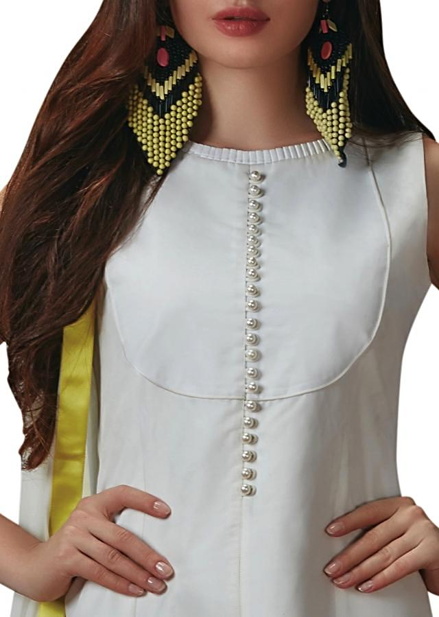 White anarkali suit in taffeta silk with resham cut work embroidery