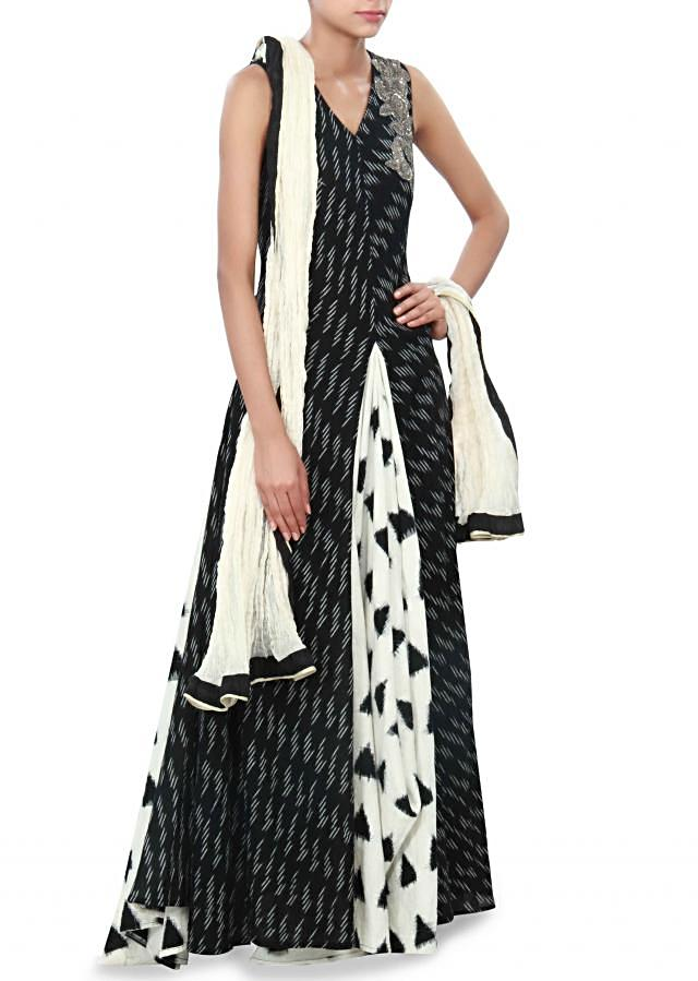 White and black anarkali suit enhanced in weave embroidery only on Kalki