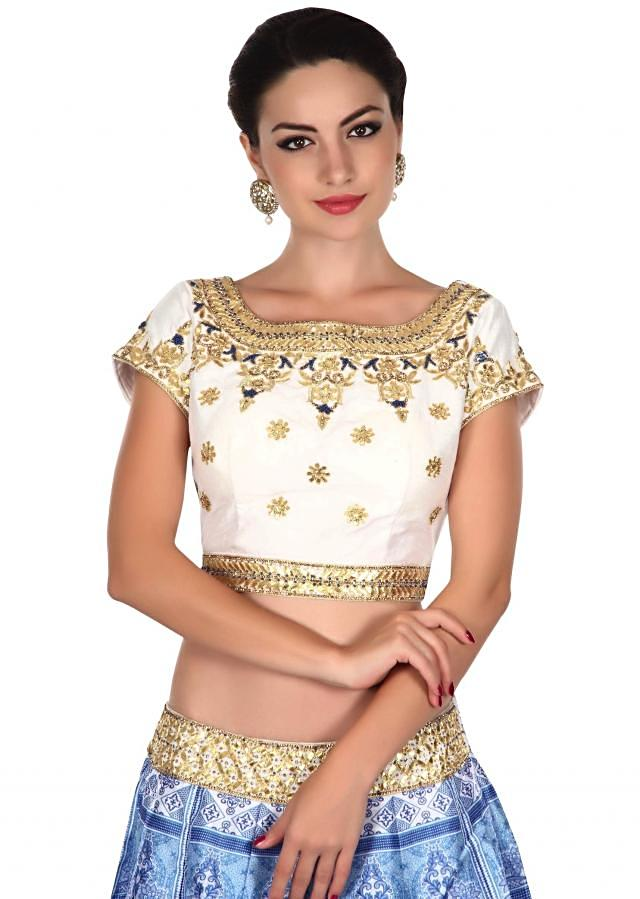 White and blue lehenga adorn in gotta patch embroidery only on Kalki