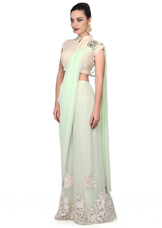 White and mint green saree gown enhanced in sequin cut work border only on Kalki