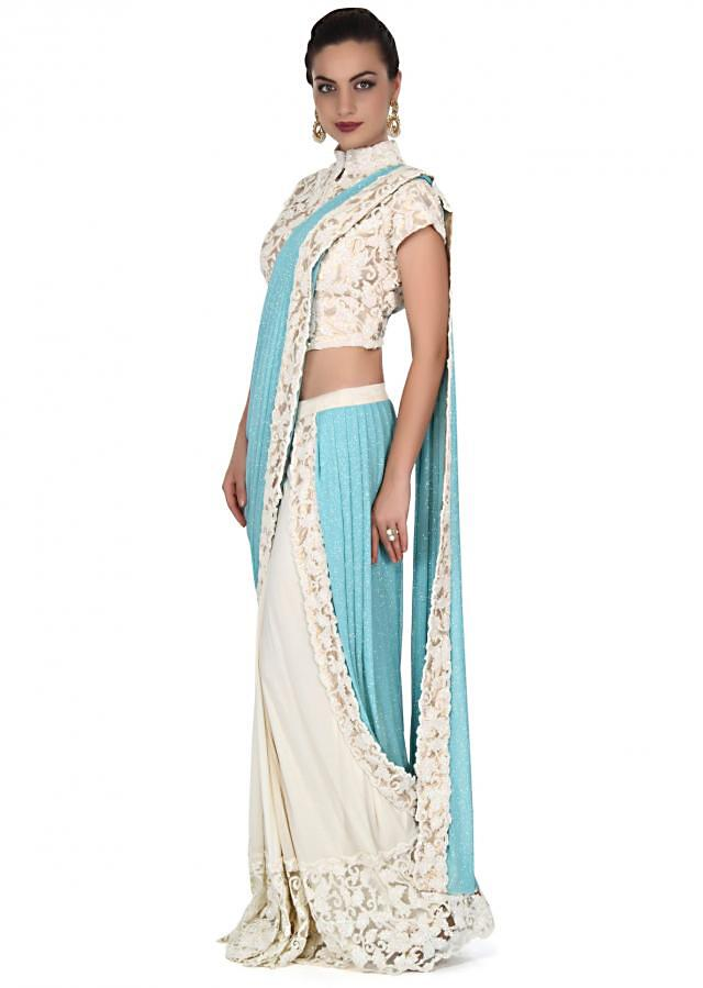 White and turq saree gown enhanced in sequin cut work border only on Kalki