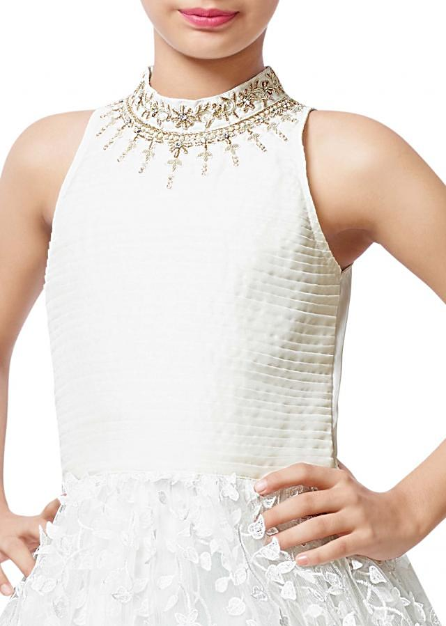 White embroidered gown with pleated bodice