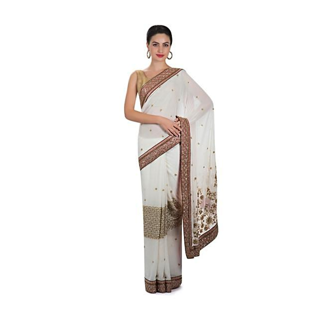 White georgette saree adorned with pearl, sequins and cut dana work only on Kalki
