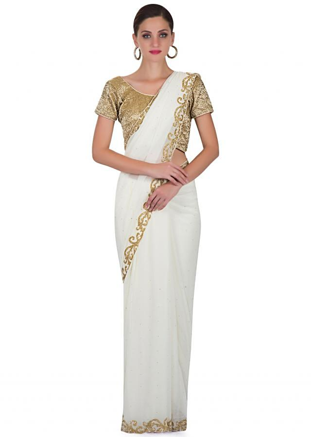 White Georgette Saree and Fancy Stitched Blouse Studded with Cut Dana only on Kalki