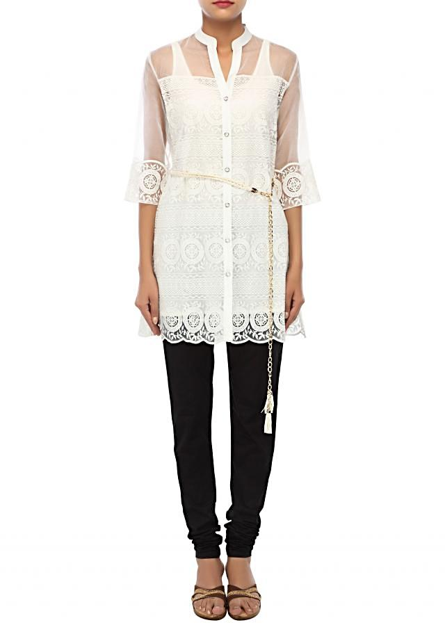 White kurti embellished in thread embroidery only on Kalki