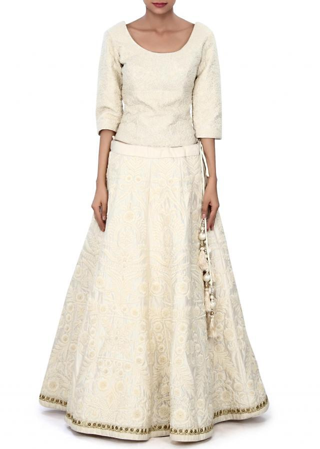 White lehenga adorn in embossed thread embroidery only on Kalki