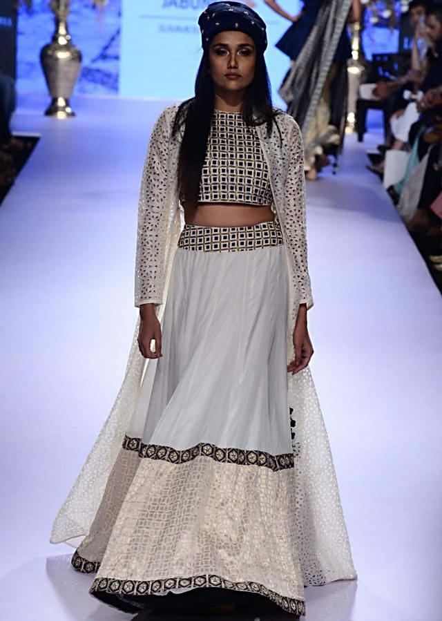 Model walks the ramp in white lehenga  with long jacket blouse for  SVA collection named Istanbul at Lakme Fashion Week Summer Resort 2015