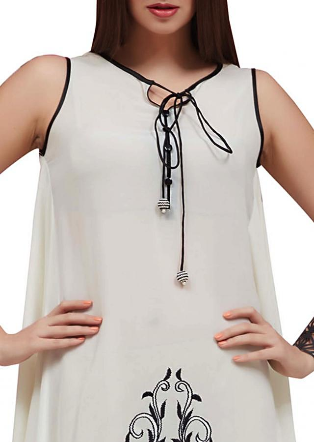 White long black embroidered kurti with tie up at neckline