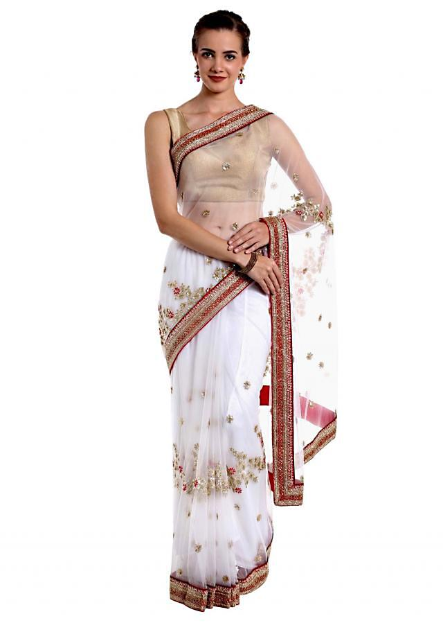 White net saree embellished with sequins  only on Kalki