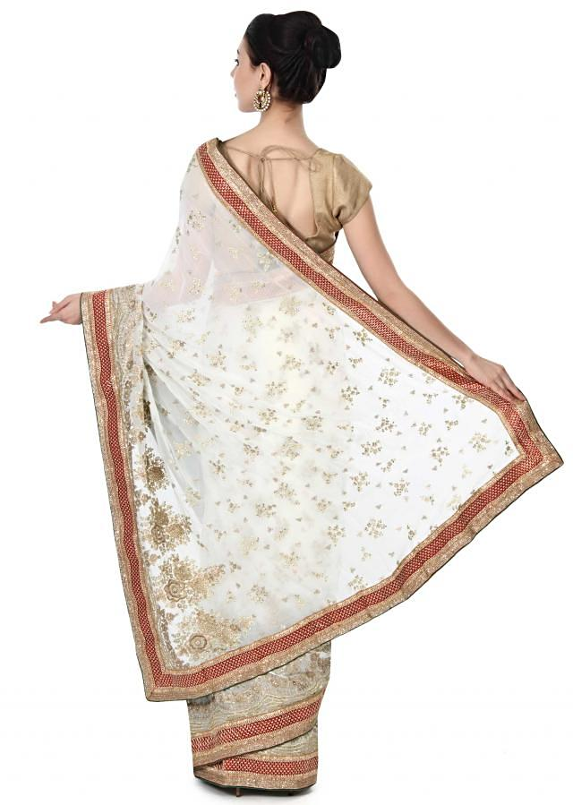 White saree adorn in floral motif embroidery in sequin only on Kalki